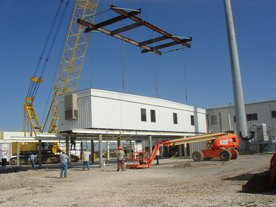 Crane-setting modular office building for Acadian Contractors