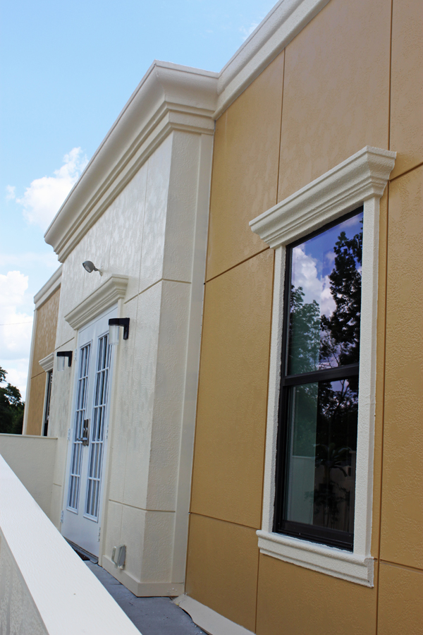 Crown molding detail on windows and roofline