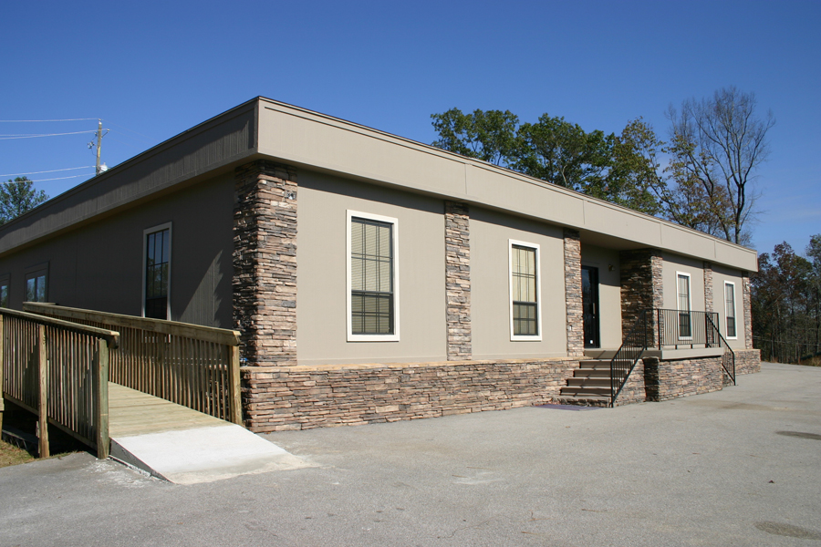 Modular Building with G mansard, recessed entry and rock columns